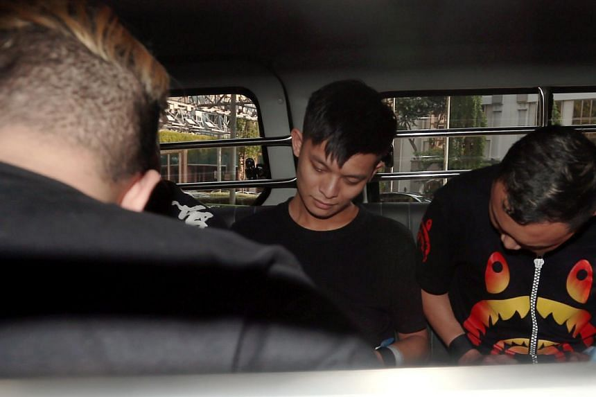 Chan Jia Xing (centre), one of the suspects charged with the murder of Mr Satheesh Noel Gobidass.