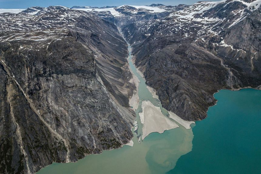 Sediment spreads into the water north of Sermilik Fjord in Greenland, on June 28, 2019.