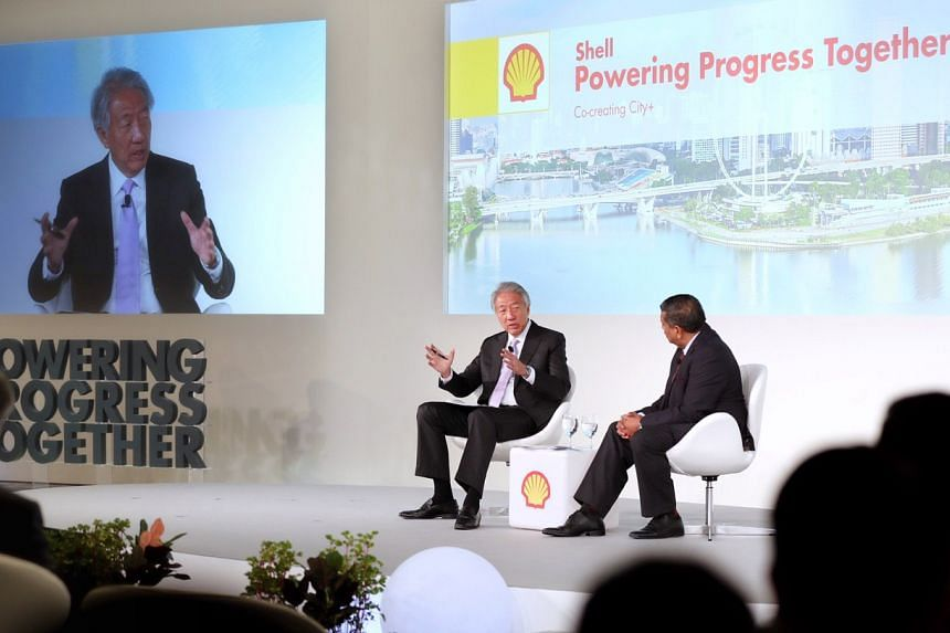 Senior Minister Teo Chee Hean (left) drew attention in particular to the Republic's efforts in going low-carbon and managing rising sea levels in a speech at the sixth Asian edition of the Shell Powering Progress Together forum.