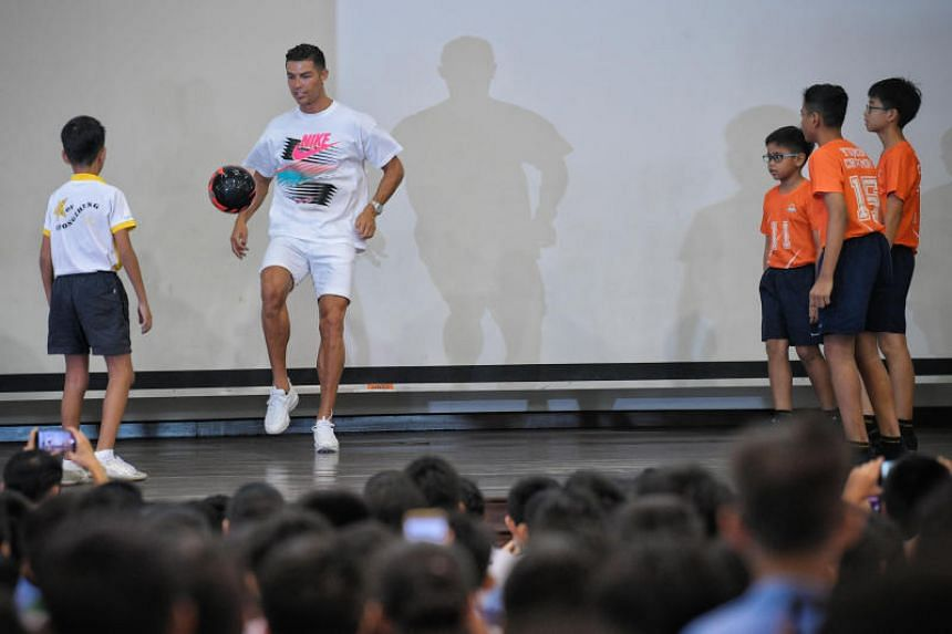 Cristiano Ronaldo demonstrating some tricks with the football in the Yumin school hall.