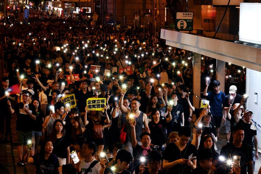 Protesters in Hennessy Road, near Hong Kong's police headquarters, during the annual pro-democracy march on July 1, 2019.