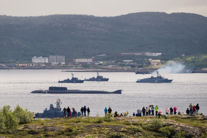 Russian navy ships and a submarine take part in a naval parade at the Russian port of Severomorsk on July 31, 2016.