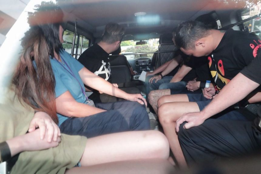 Suspects of the Orchard Towers murder arriving at the State Courts on July 4, 2019.