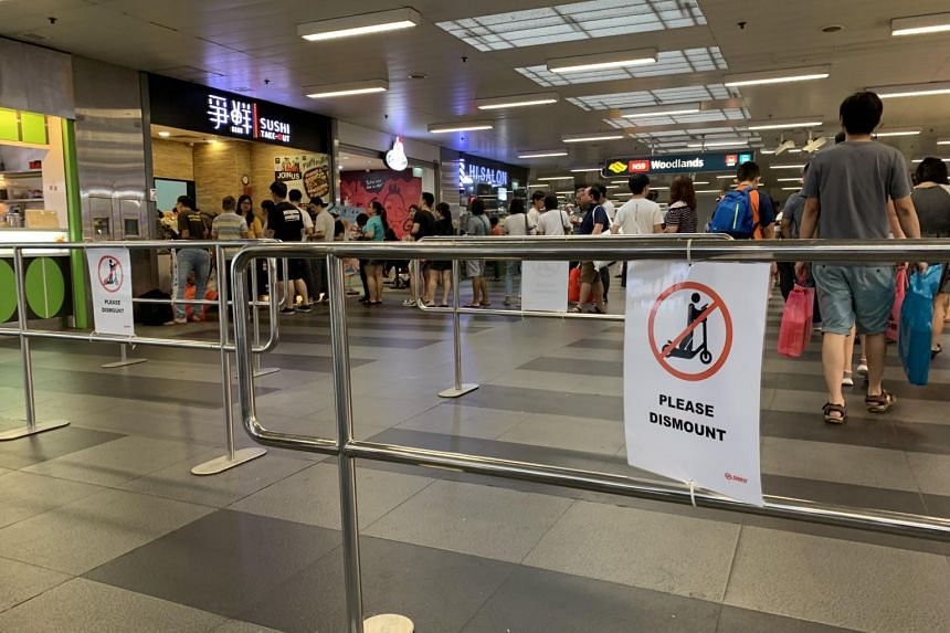 Metal barriers were set up at Woodlands MRT station, with the aim of getting Personal Mobility Device users to dismount when crossing through the station's concourse.