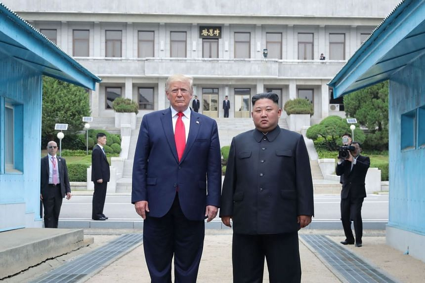 US President Donald Trump and North Korean leader Kim Jong Un stand north of the Military Demarcation Line that divides North and South Korea.