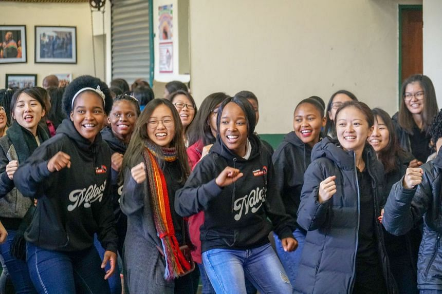 Singapore community choir ONE Chamber Choir performing for villagers in Limpopo, South Africa, with the Ndlovu Youth Choir last year. Raffles Singers, a Raffles Institution alumni choir, won the overall grand prize at the Bratislava Choir Festival la