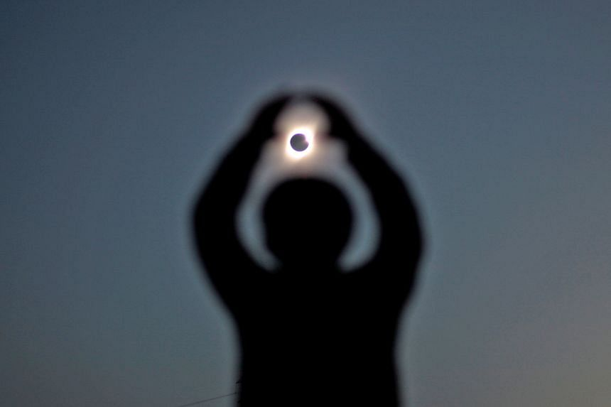 Astronomers and amateur skywatchers (left and above) were treated to a total solar eclipse in part of Chile's northern desert, an area famed for its clear skies and host to some of the world's largest telescopes. More than 200,000 people flocked to t