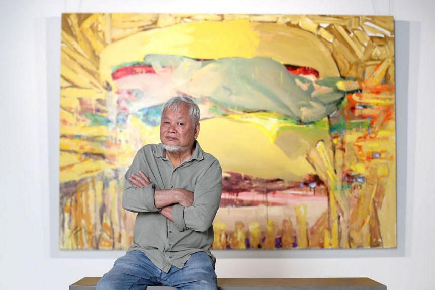 New Yorktrained artist Wong Keen (above) with his Still A Burger work at his exhibition titled Theatre Of Enigmas.