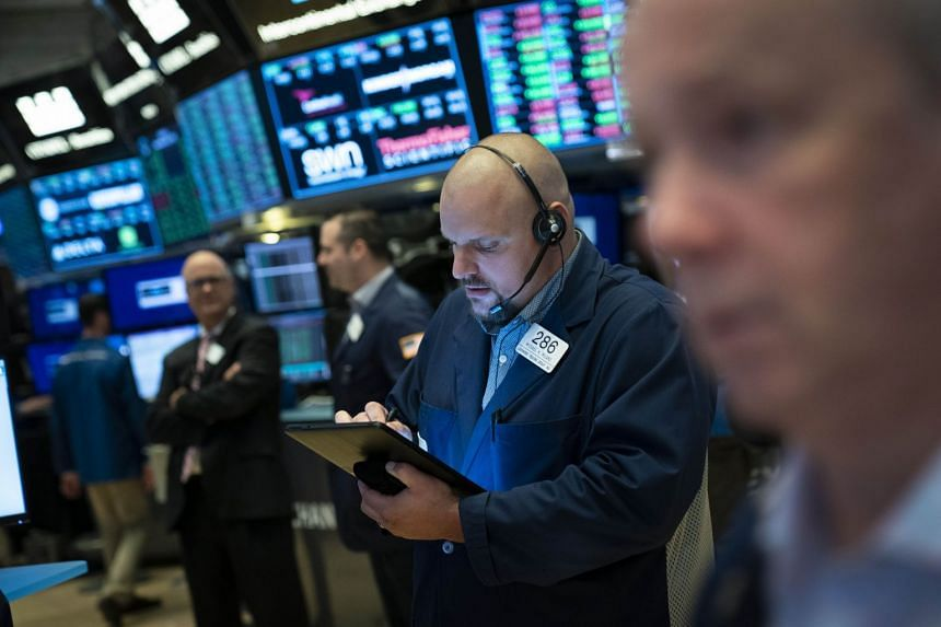 Traders work on the floor of the New York Stock Exchange before the July 4 holiday.