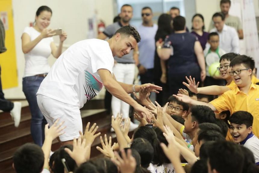Cristiano Ronaldo meets pupils of Yumin Primary School and Chongzheng Primary School on July 4, 2019.