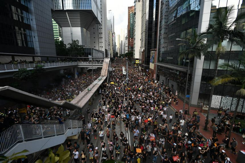 Protesters in Hennessy Road next to the police headquarters during the annual pro-democracy march in Hong Kong on July 1, 2019.
