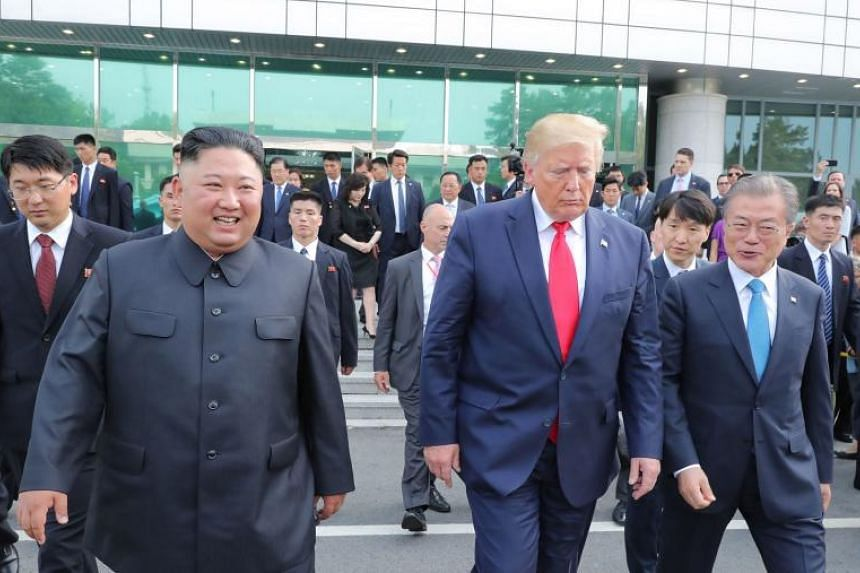 North Korean leader Kim Jong Un with US President Donald Trump and South Korean President Moon Jae-in in Panmunjom, in the Demilitarised Zone between the two Koreas, on June 30, 2019.