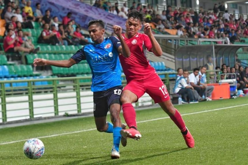 Home United's midfielder Arshad Shamin (blue) squaring off with Young Lions defender Syahrul Sazali in their Singapore Premier League match at Jalan Besar on July 3, 2019.