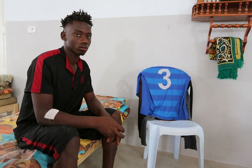 An African migrant who, a government source and the Tunisian Red Crescent said, was rescued after the boat he was travelling capsized in the Mediterranean Sea off the Tunisian Coast, sits inside a local Red Crescent chapter in Zarzis, Tunisia July 4,