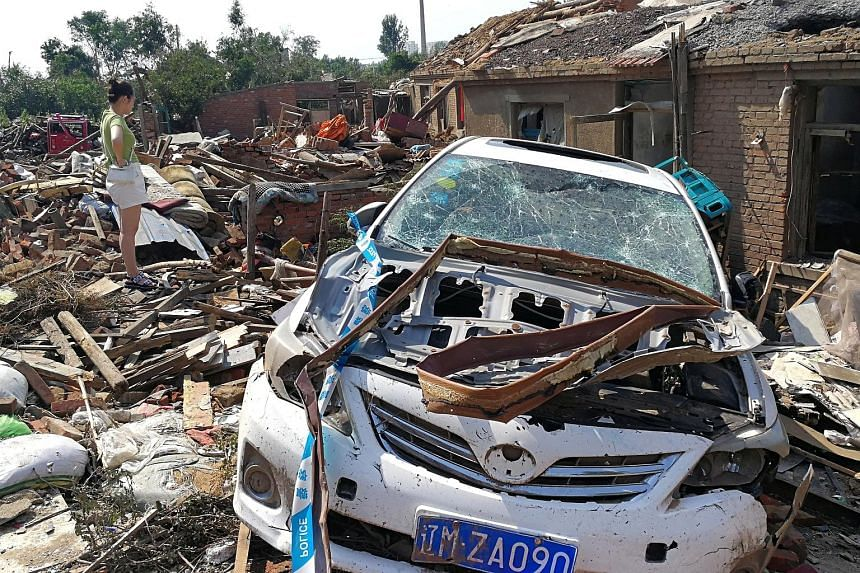 The damage caused by a rare tornado in Kaiyuan city, in China's north-eastern Liaoning province, seen yesterday. PHOTO: REUTERS