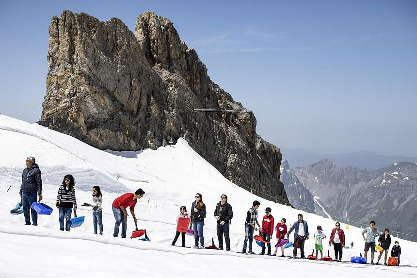 Expatriates like Switzerland for its high pay and quality of life. Many also see the nation of iconic ski resorts as a great place to raise children. PHOTO: EPA-EFE