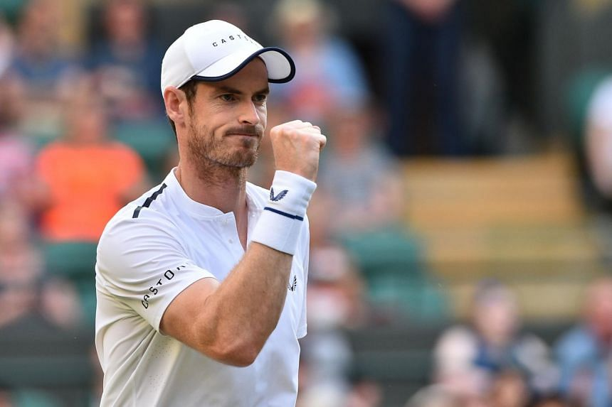 Britain's Andy Murray celebrates after winning a point against Romania's Marius Copil and France's Ugo Humbert during their men's doubles second round match on the fourth day of the 2019 Wimbledon Championships on July 4, 2019.