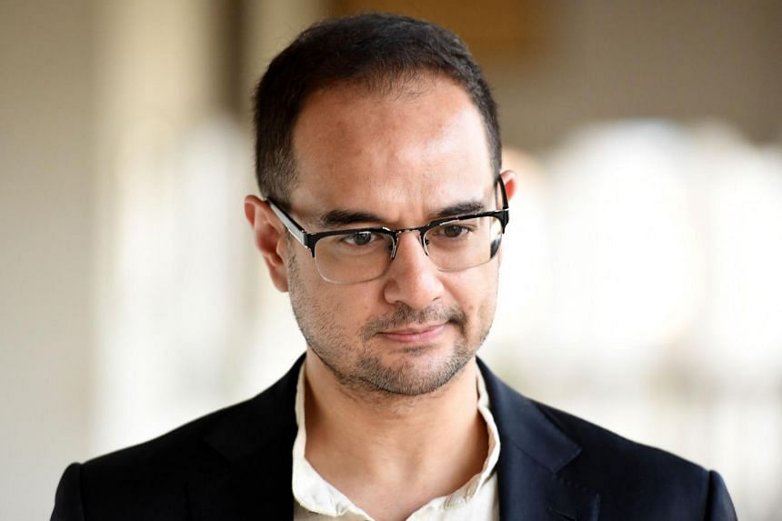 Hollywood producer Riza Aziz arrives at court in Kuala Lumpur on July 5, 2019. The stepson of former Malaysian Prime Minister Najib Razak is being charged with money laundering.