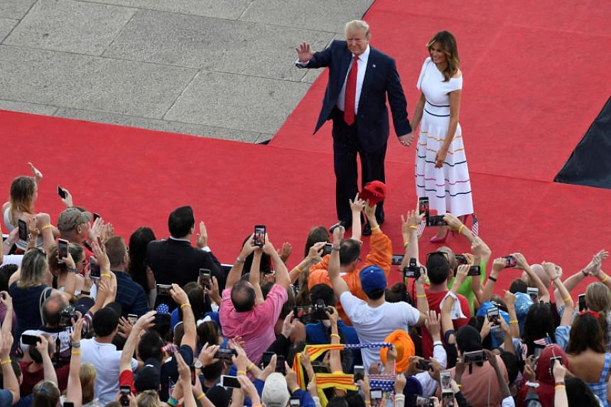 US President Donald Trump, walking with first lady Melania Trump, arrives to speak during an Independence Day celebration in front of the Lincoln Memorial in Washington, on July 4, 2019.