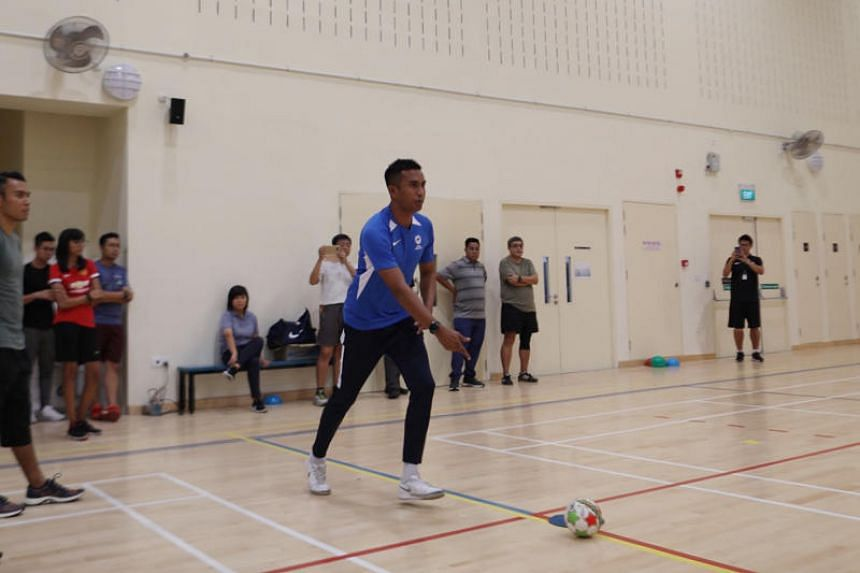 Asian Football Confederation Level 2 coach and former S-League forward Farhan Farook leads primary school teachers in futsal drills during the FAS workshop for the Under-10 Inter-School Futsal Challenge 2019.
