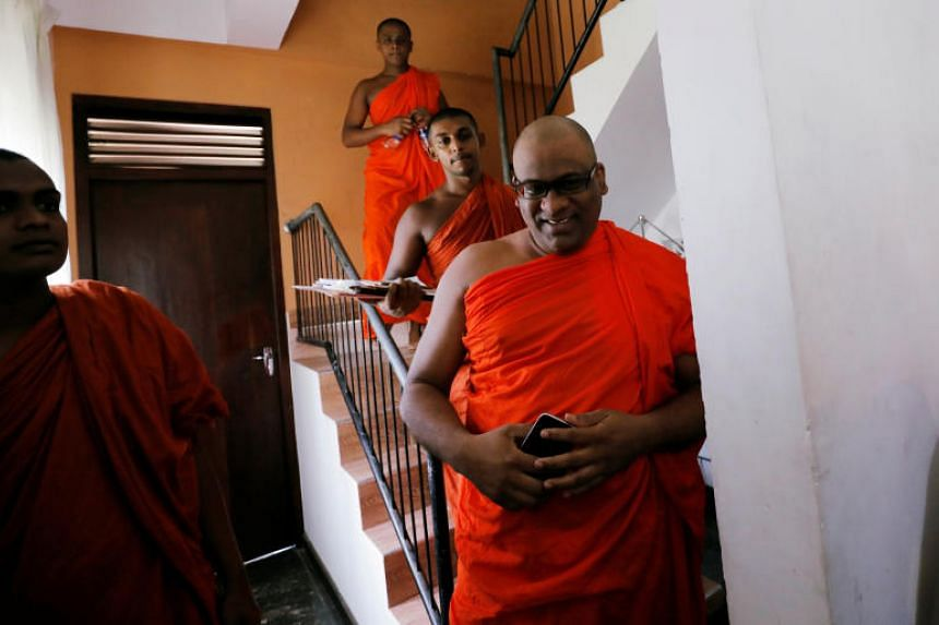 Galagoda Aththe Gnanasara, the influential head of Buddhist nationalist group Bodu Bala Sena, arrives at a news conference in Colombo on May 28, 2019.