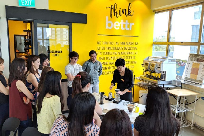 Pamela Chng (in black), founder of Bettr Barista, conducting a coffee-related workshop.  Bettr Barista has a four-month holistic training programme for women aged 17 to 50, as well as at-risk youth of both genders such as school dropouts.