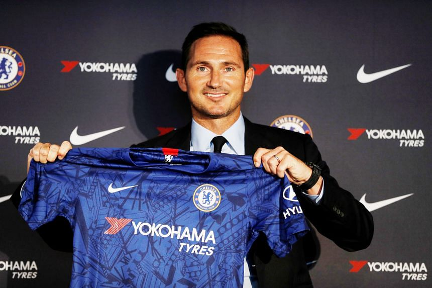 New manager Frank Lampard holding up a Chelsea jersey during his unveiling at Stamford Bridge yesterday. The Blues legend led Derby to the Championship play-off final, which they lost to Aston Villa, in May. PHOTO: REUTERS