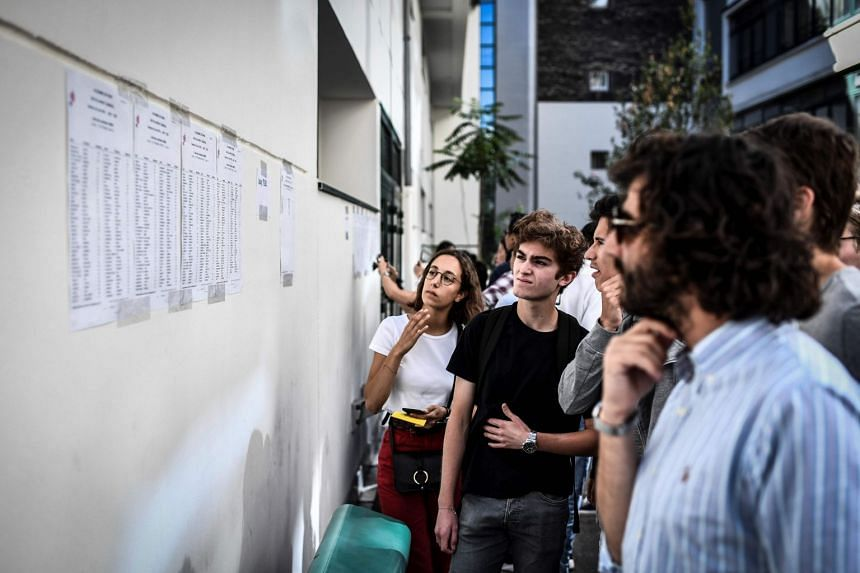 Students check the results of the baccalaureat exam at the Fresnel high school in Paris on July 5, 2019.