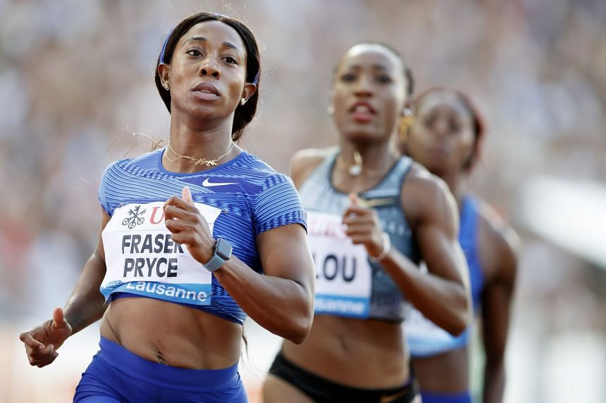 Fraser-Pryce (far left) competes in the women's 100m race.