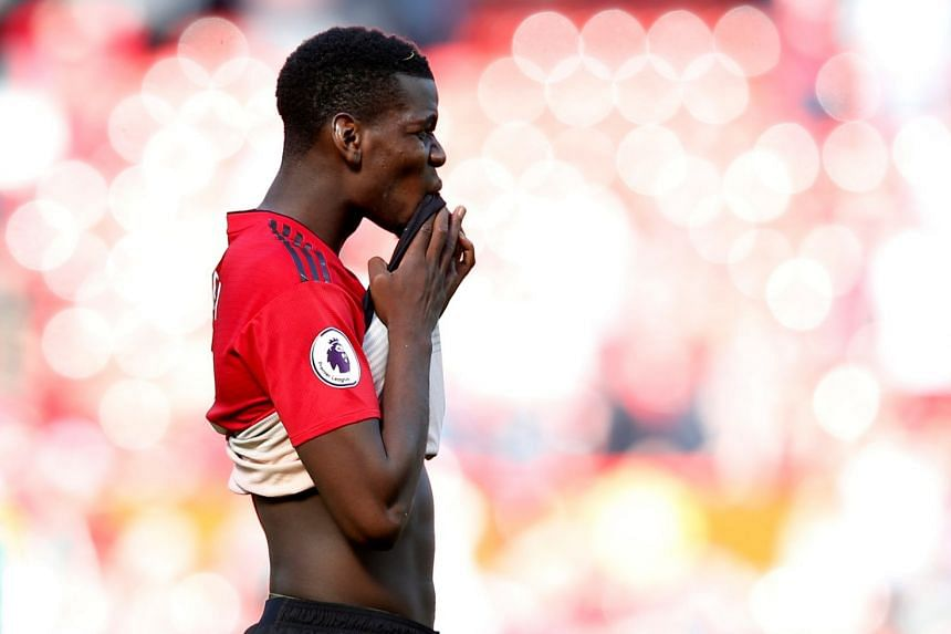 Manchester United's Paul Pogba looks dejected after a match.