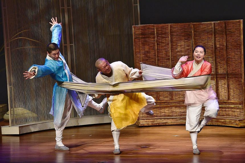 The China National Theatre for Children performing Three Monks at the opening ceremony yesterday at the China Cultural Centre. The Singapore Hokkien Huay Kuan Arts and Cultural Troupe also put up a performance. ST PHOTO: DESMOND WEE