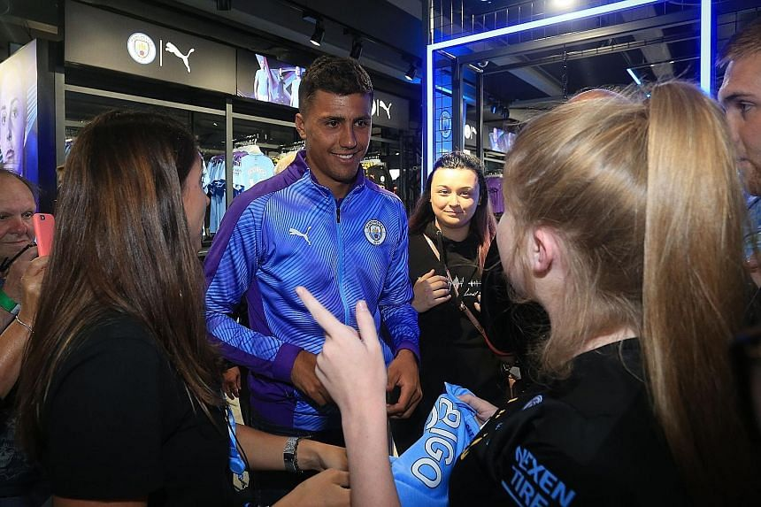 Manchester City's new signing Rodri meets fans during a press conference at the Etihad Stadium on Thursday. The midfielder officially joined City a day after Atletico Madrid revealed his €70 million release clause was triggered.