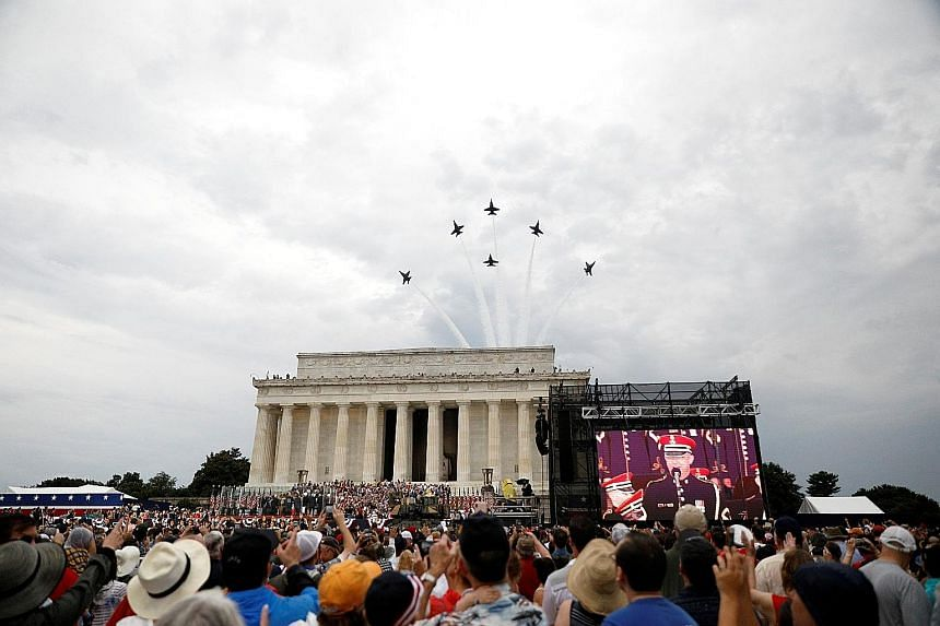 """President Donald Trump addressing the crowd from the Lincoln Memorial, where Martin Luther King Jr delivered his """"I Have a Dream"""" speech 56 years ago. Fireworks exploding over the East River as part of Independence Day celebrations in New York. PHOTO"""