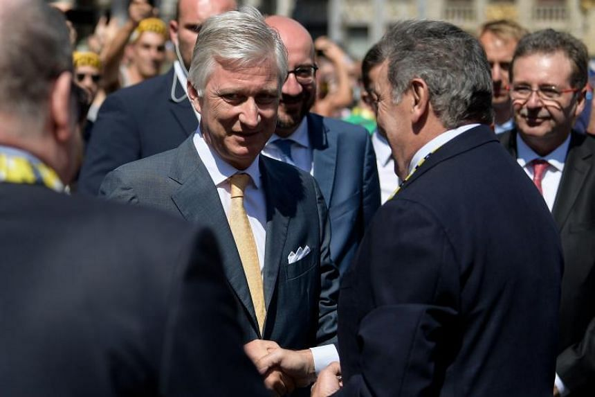 King Philippe of Belgium (left) meets Belgian legend Eddy Merckx before the start of the 106th edition of the Tour de France, on July 6, 2019.