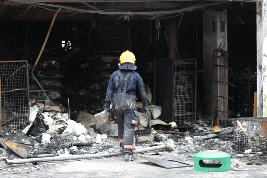 SCDF personnel working at the scene of the fire.