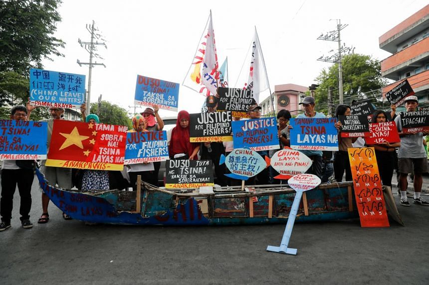 Activists protesting against the alleged sinking of a fishing boat by a Chinese vessel in Manila, on June 19, 2019.