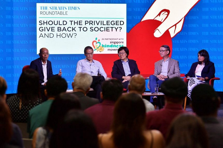 A panel discussion on the topic of privilege in Singapore and giving back to society was moderated by (from left) Straits Times editor-at-large Han Fook Kwang, and involved Lien Foundation chairman Laurence Lien; Singapore Management University profe