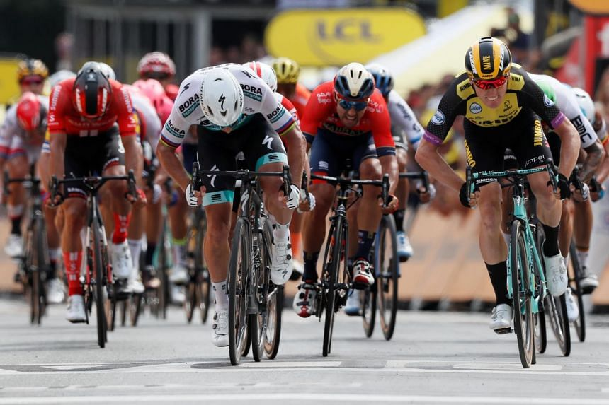Team Jumbo-Visma's Dutch rider Mike Teunissen of the Netherlands wins the Tour de France's 194.5-km Stage 1 around Belgium on July 6, 2019 from Bora-Hansgrohe rider Peter Sagan of Slovakia.