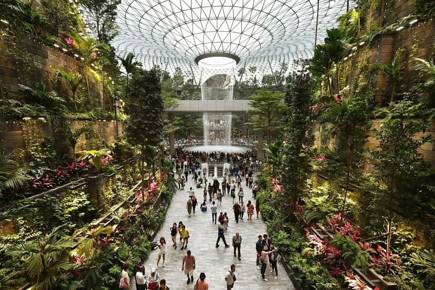 Designed by award-winning firm Safdie Architects, Jewel Changi Airport's centrepiece is a 40m indoor waterfall (above) alongside a five-storey garden with more than 2,000 trees and 100,000 shrubs from all over the globe.