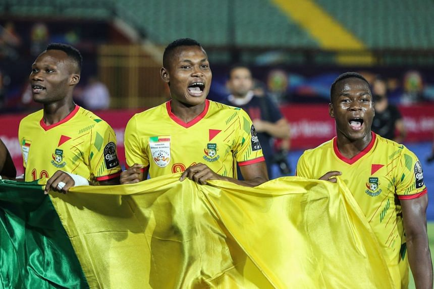 Benin players celebrate after winning against Morocco.