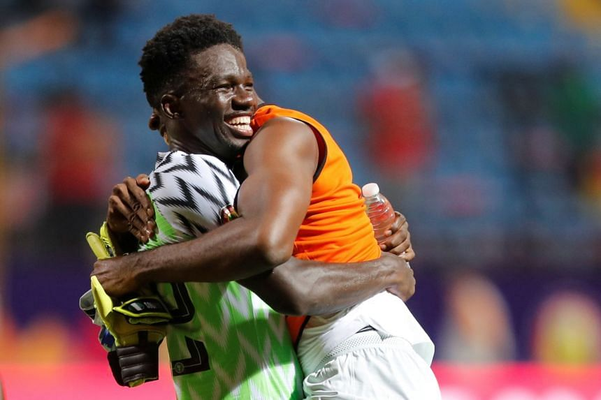 Nigeria's Kenneth Omeruo celebrates after the match.