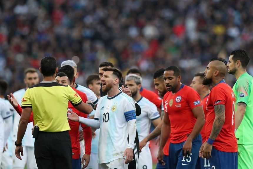 Argentina's Lionel Messi reacts after being shown a red card by referee Mario Diaz de Vivar.