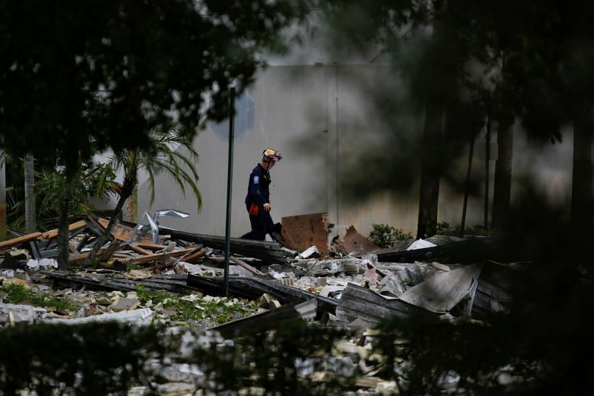A firefighter inspects an affected area after the blast.