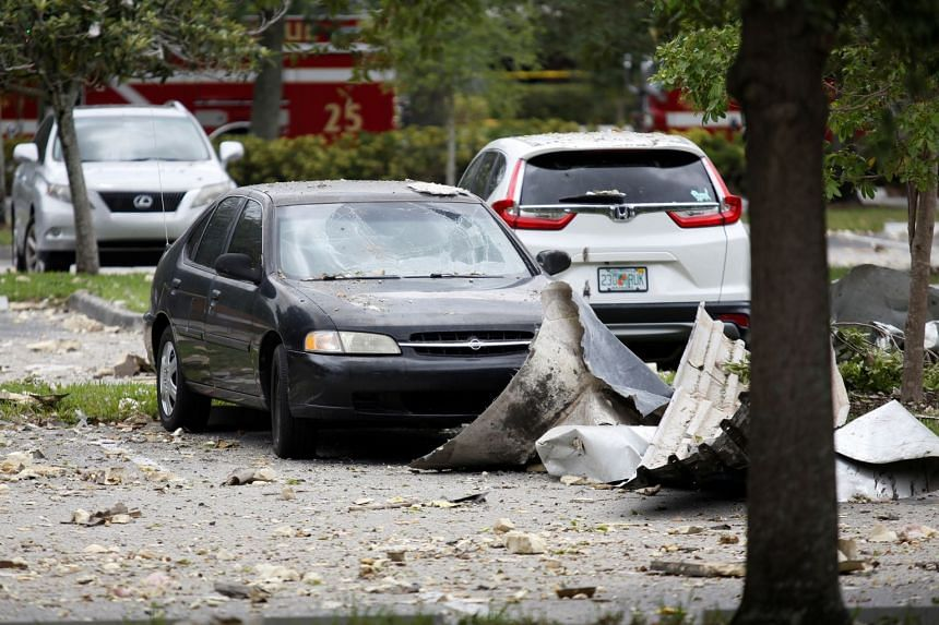 Debris is seen in a parking lot after the explosion.