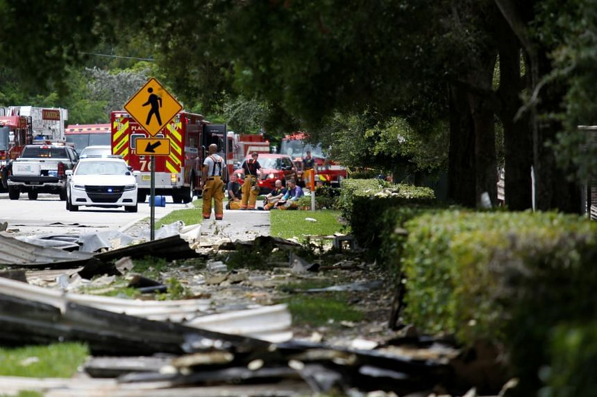 Rescue sources are seen in an affected area after the blast.