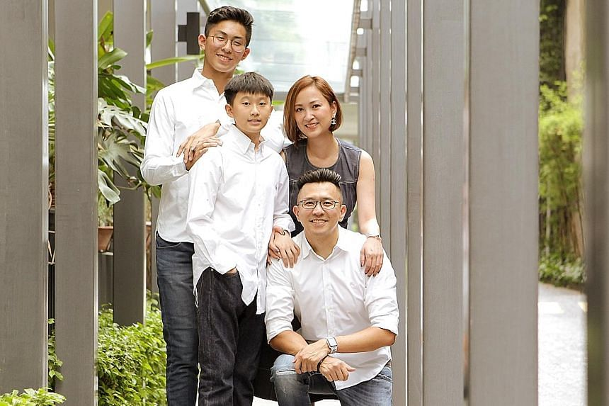 Finance executive Adam Tan with his wife Teresa Lim and their sons Isaac, 16, and Josiah, 13. Apart from investing in unit trusts, equities and property, he has invested in endowment plans and investment-linked plans for his sons' education.
