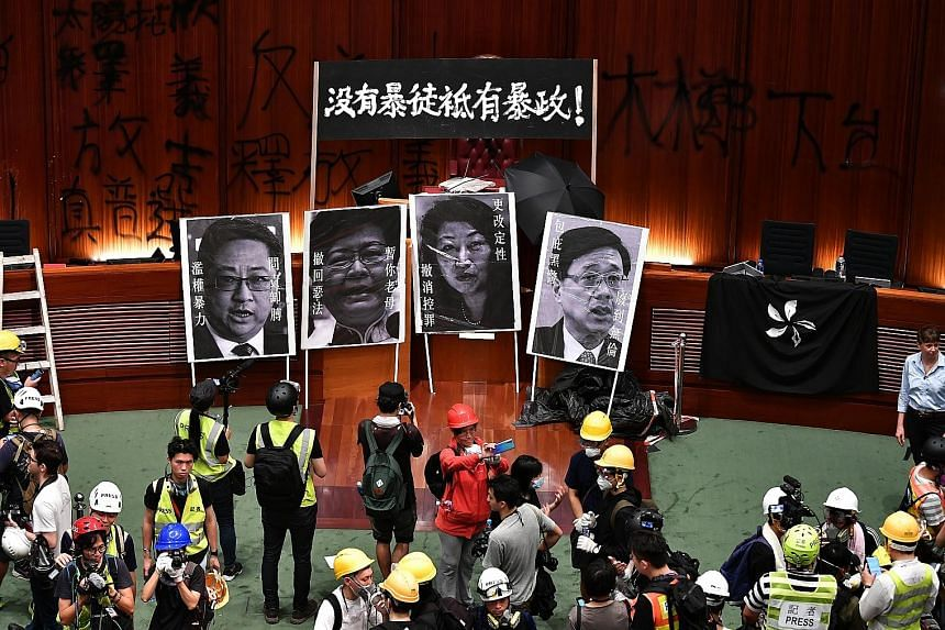 Protesters and media inside the Legislative Council building last Monday, on the 22nd anniversary of the handover of Hong Kong. Experts say the evolution of protests has been coloured by the larger political dynamic.