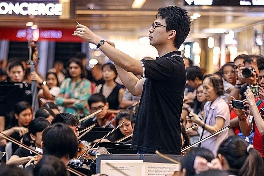 The Orchestra of the Music Makers performing for shoppers at the Paragon's main atrium yesterday, as part of the Singapore Press Holdings' Gift of Music series. The home-grown ensemble's set included classical and contemporary pieces such as Richard