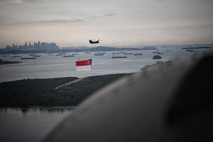 Even when the Chinook has flown past the Padang, people are still watching it along its route, and the integrity of the flag is maintained until it is out of sight.