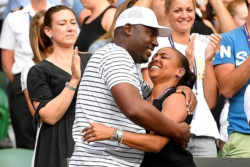 Above: Corey and Candi Gauff celebrating after their daughter Cori won her match. Cori says her dad's positive thinking and her mum's calm nature is a good mix for her. Left: Cori in ecstasy after beating Polona Hercog in the Wimbledon round of 32 on